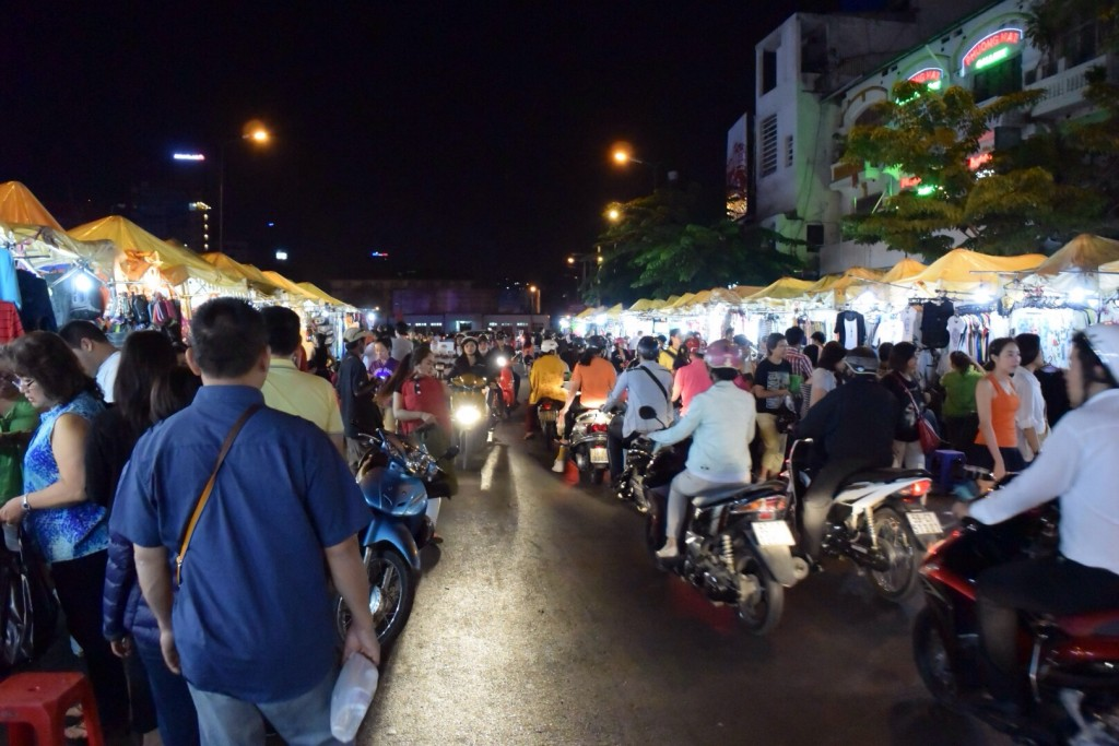 Mopeds making their way through the night market in Ho Chi Minh City